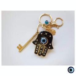 מחזיק מפתחות חמסה משובץ זהב שחור ינשוף עין תכלת מפתח זהב 1
