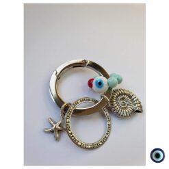 מחזיק מפתחות בניחוח חוף ים - כונכיה עיגול ברכות וכוכב ים קטן 1